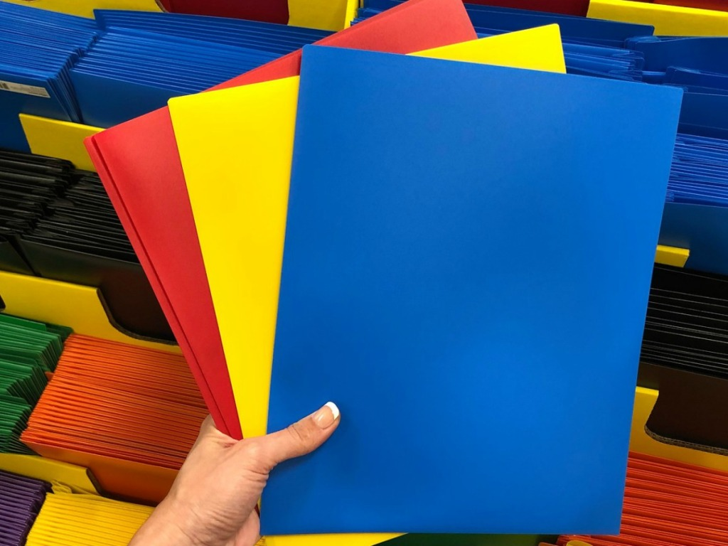 colorful Poly Folders fanned open in hand at Office Depot