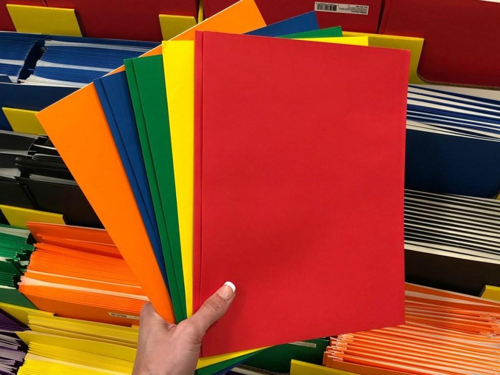 colorful paper folders fanned in front of bin