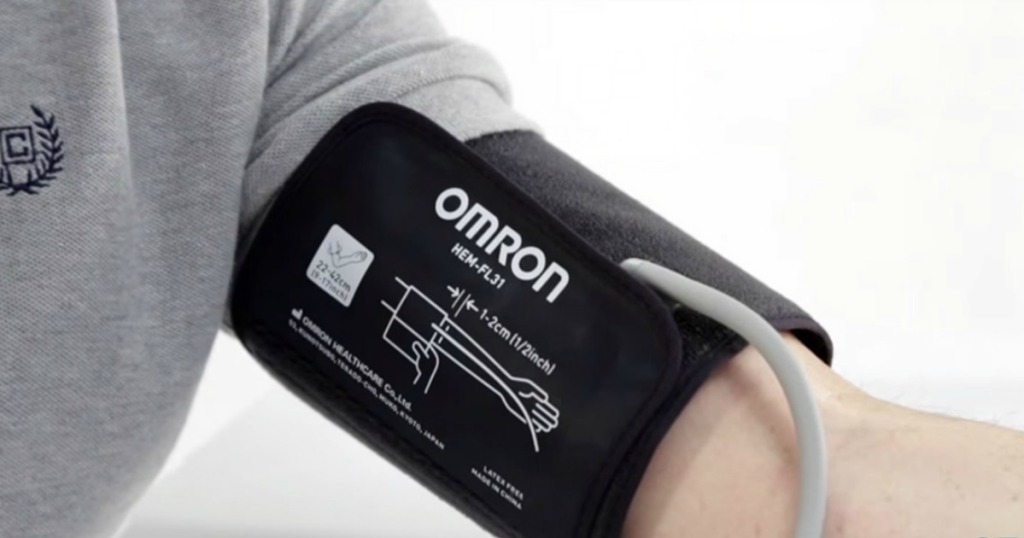 Omron blood pressure monitor on a mans arm