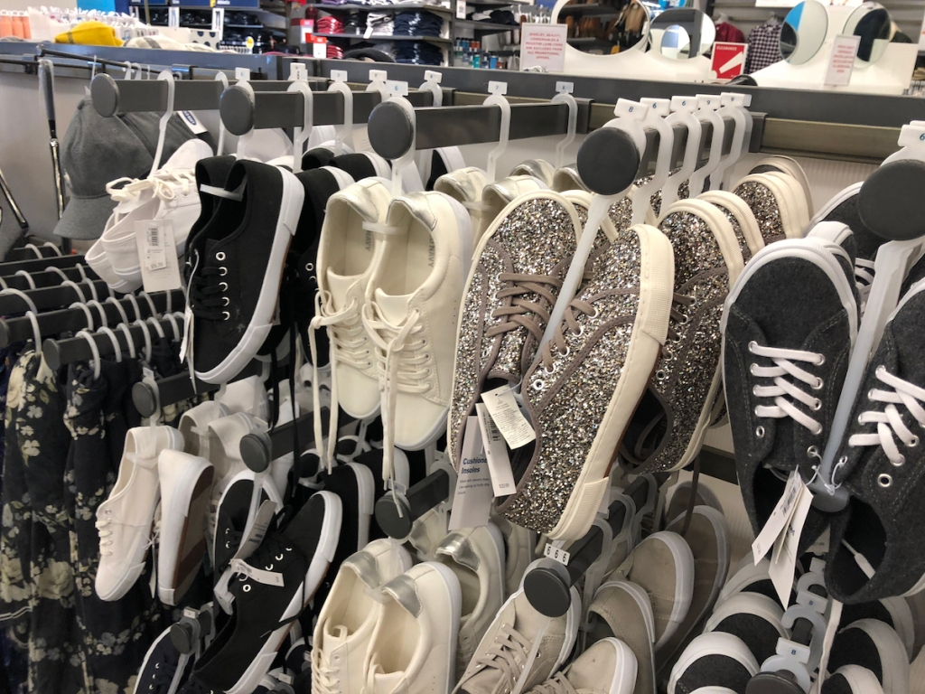 Women's sneakers hanging on hooks at Old Navy