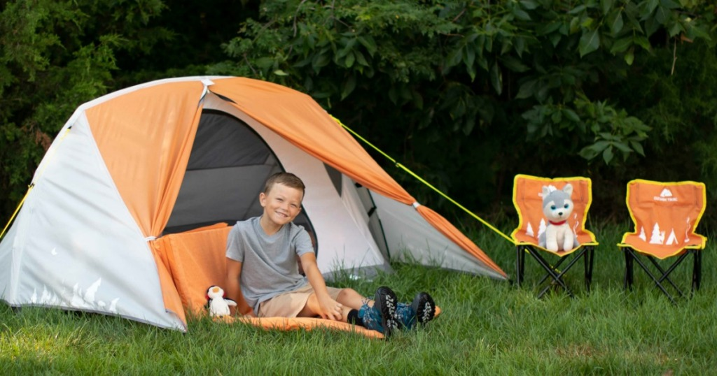 Ozark Trail 3 Person Kids Camping Tent Bundle with child sitting in on mat in front of tent