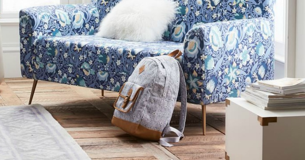 pottery barn backpack next to couch