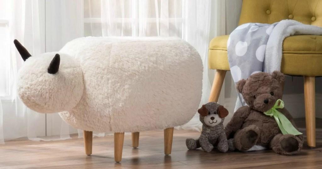 White faux fur sheep shaped ottoman