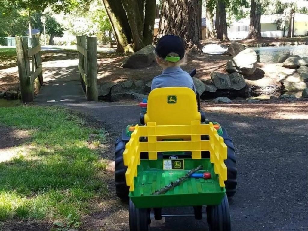 boy driving away on Peg Perego John Deere Tractor Ride-on