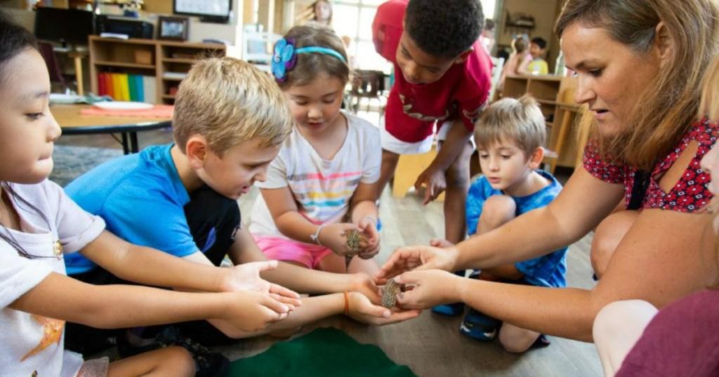 kids holding class pet