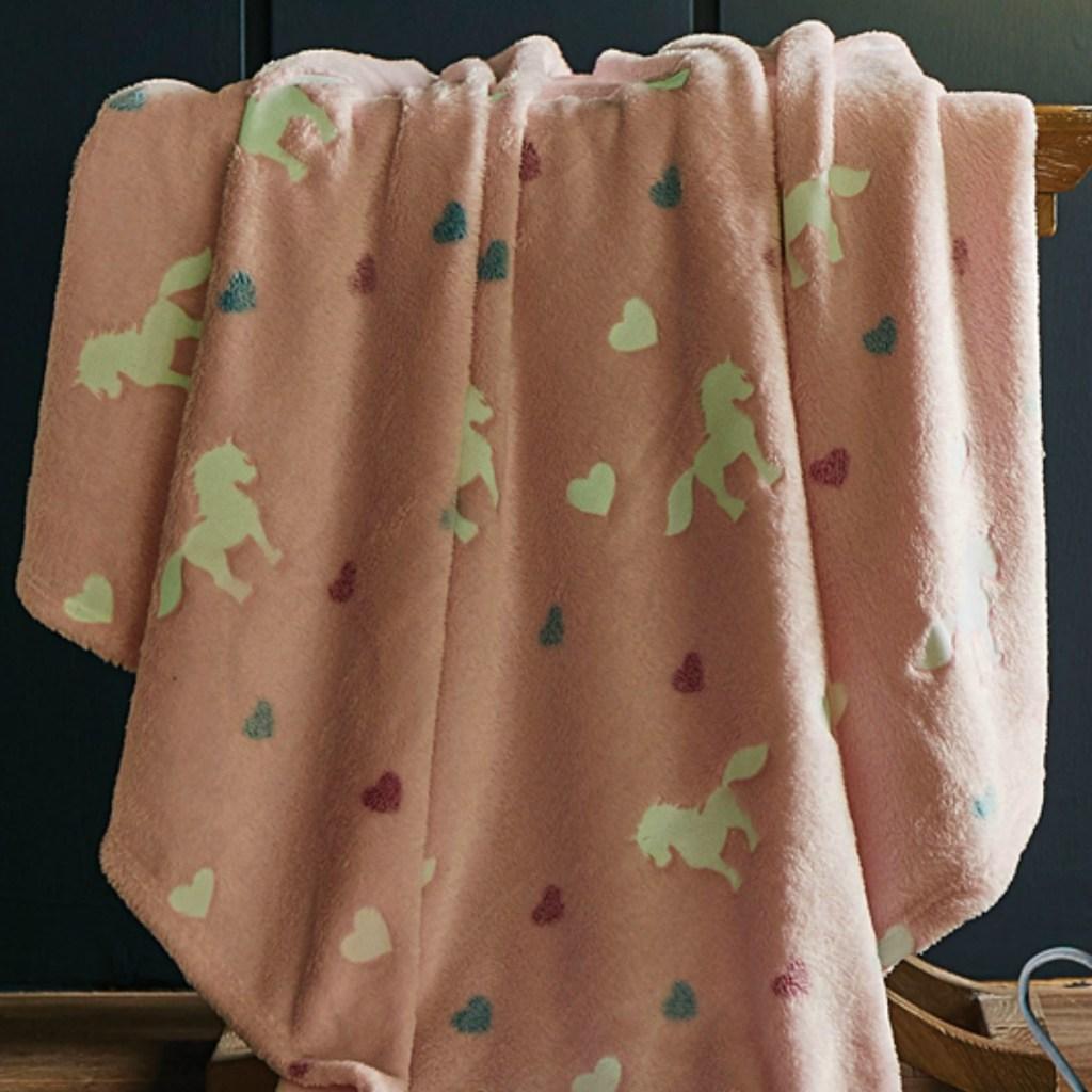 Pink plush throw blanket with unicorn print
