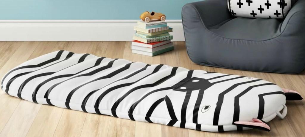 Zebra themed kids bed mat on the wooden floor