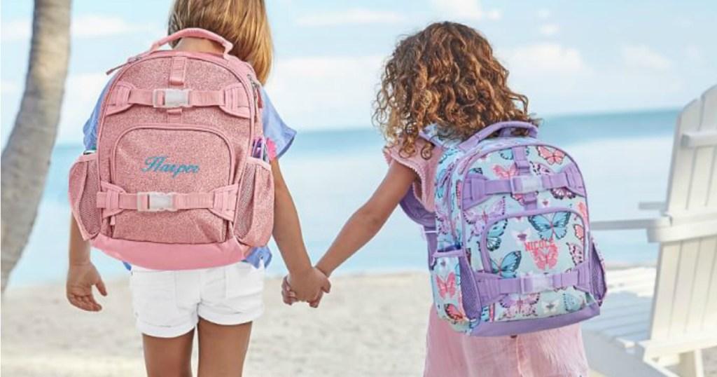 girls wearing Pottery Barn Small Backpacks