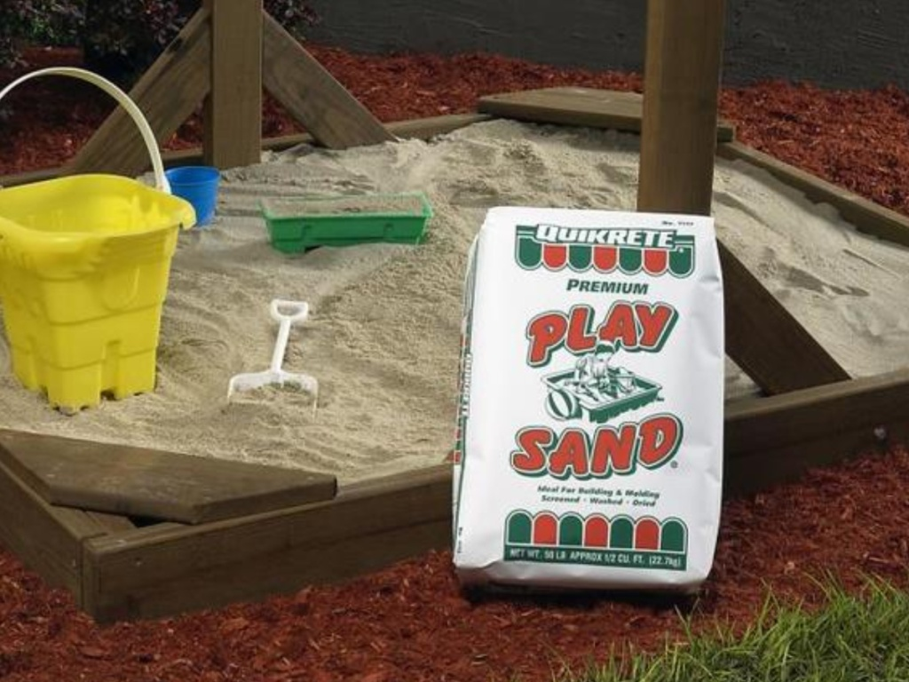 Quikrete Play Sand sitting next to a sandbox