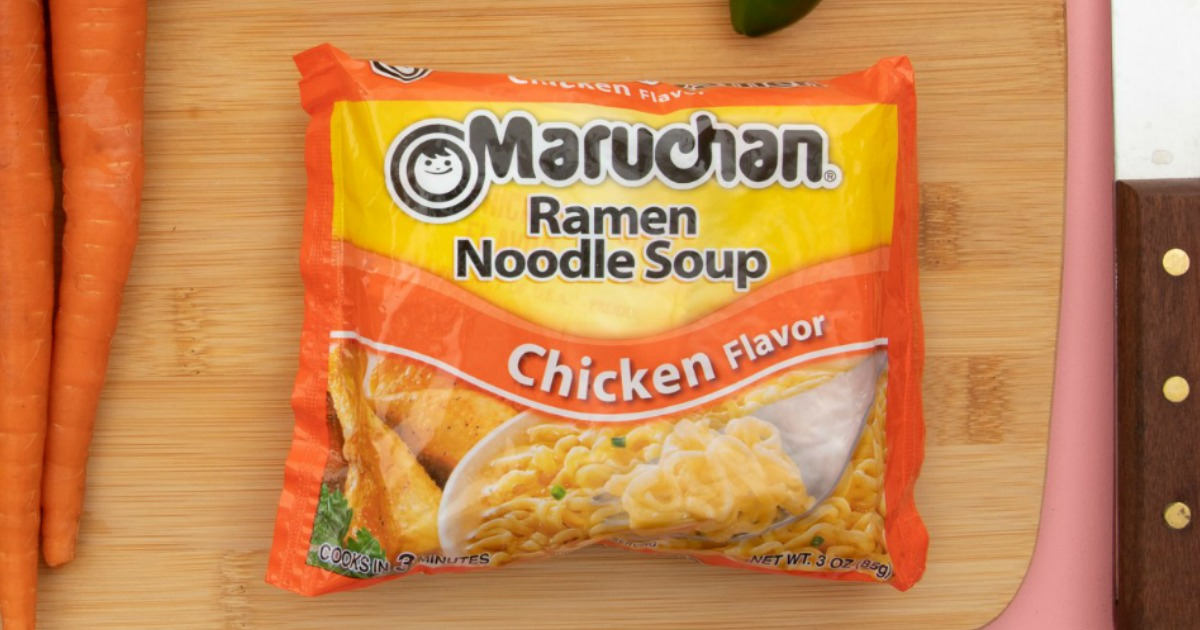 Package of ramen noodle soup chicken flavor on cutting board