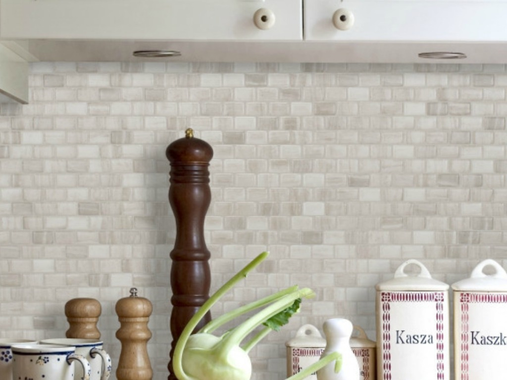 Ravenna Farro Peel & Stick Decorative Mosaic Wall Tile Backsplash 4-Pack with peppermill on kitchen counter