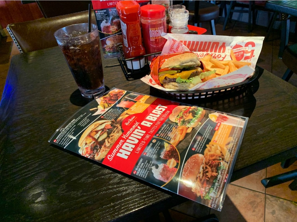 red Robin table covered with menu, burger, and drink