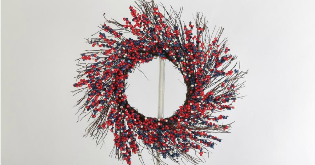 berry wreath hanging on hook
