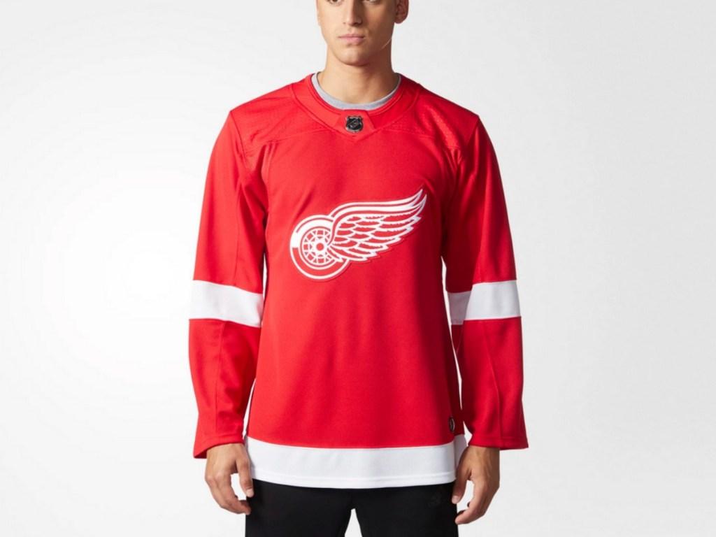 Man wearing adidas Red Wings Jersey