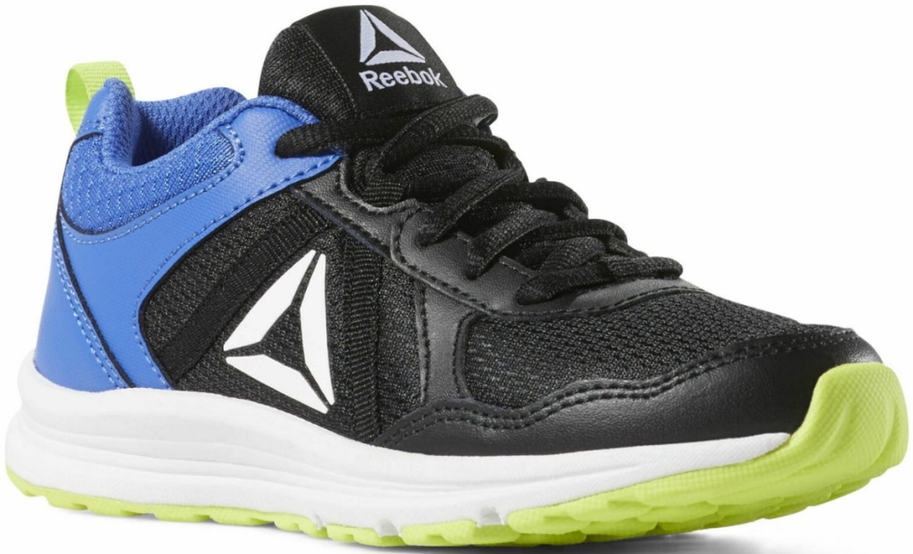 Kids Reebok brand sho in black with lime green and blue features