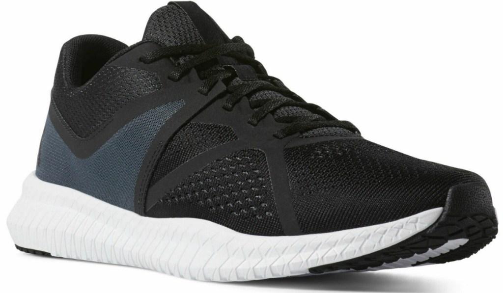 Men's Reebok Brand shoe in black with white sole