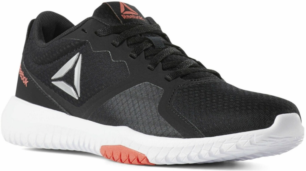 Reebok brand Women's shoe in black with white and pink