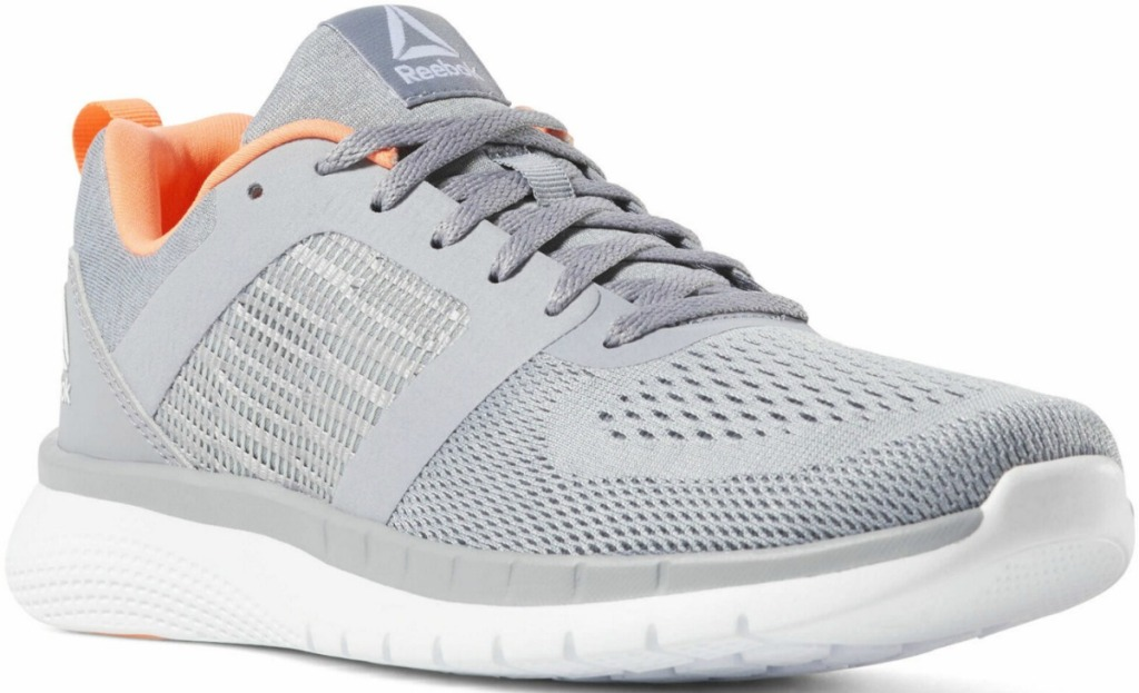 Women's Reebok brand running shoe in light gray with white and pink details