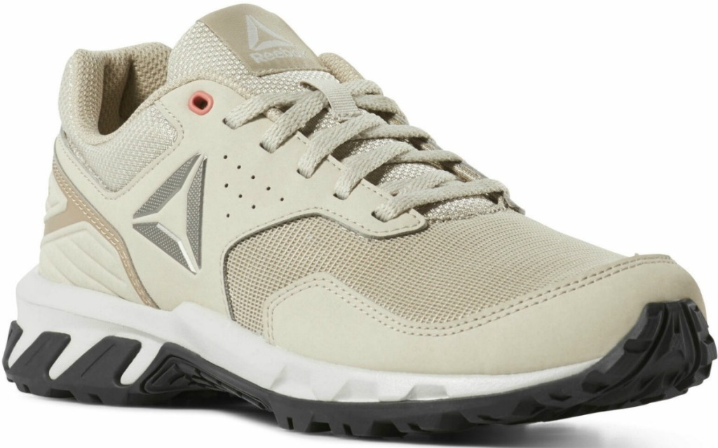 Women's Reebok Brand outdoor running shoe in beige and black