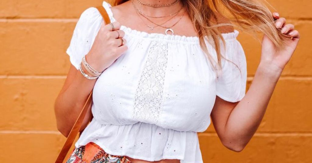 white Renee Off Shoulder Smocked Blouse on woman