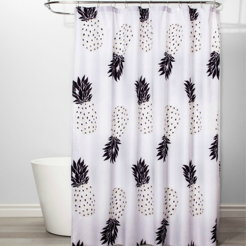 Cute Pineapple Room Essentials Shower Curtain hanging on standalone tub