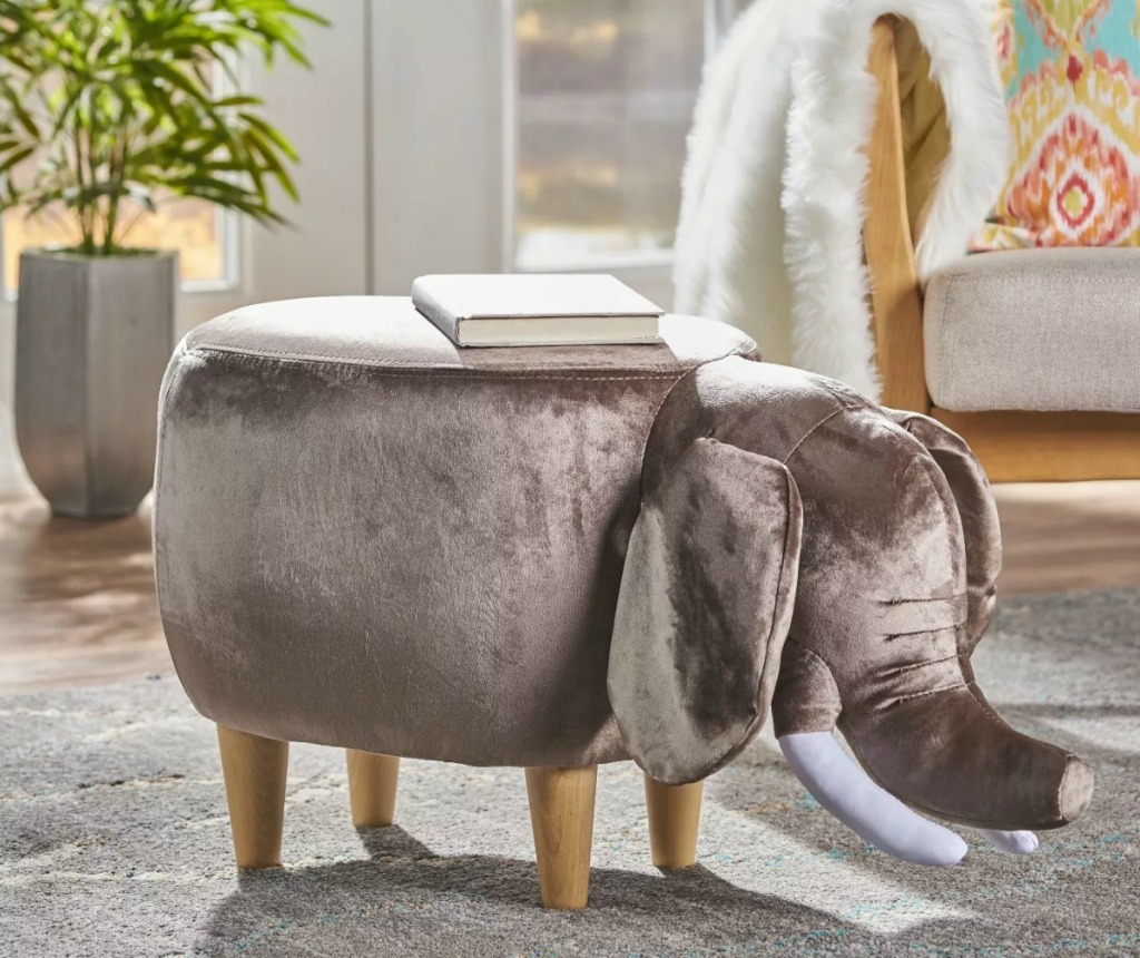 Elephant-shaped suede ottoman in living room with book