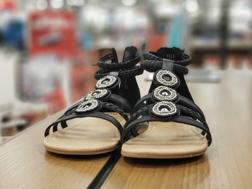 SO Melt Gladiator Sandals displayed on shelf