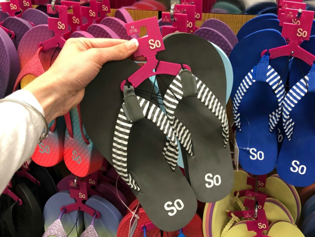 Patterned Black and blue sandals in store display