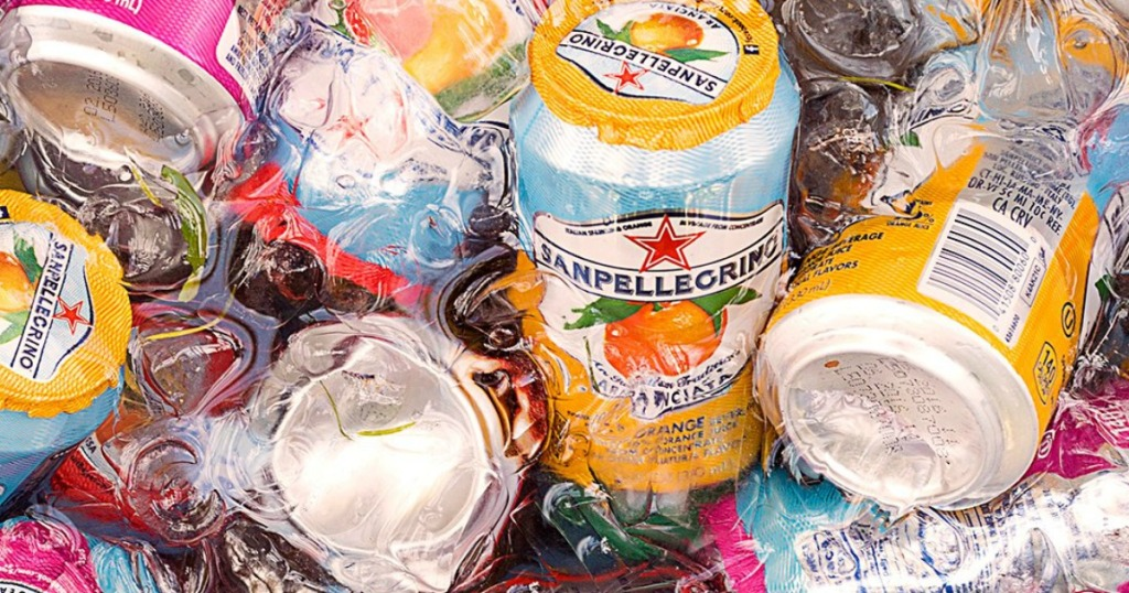 Cans of San Pellegrino Sparkling fruit juice in ice water