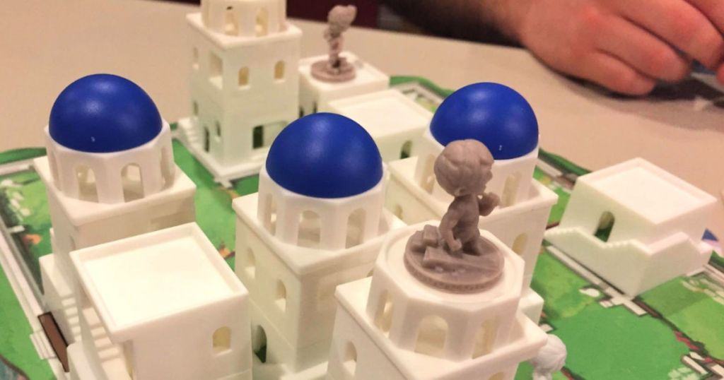 Santorini board game with house pieces
