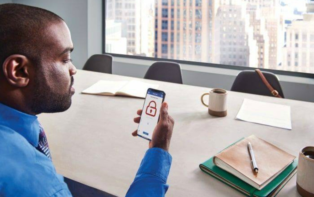 Man in office on security app
