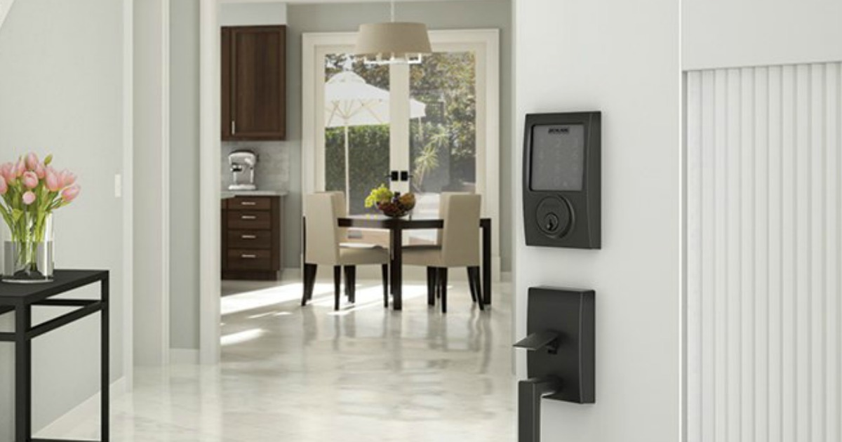 Smart deadbolt installed in large white door