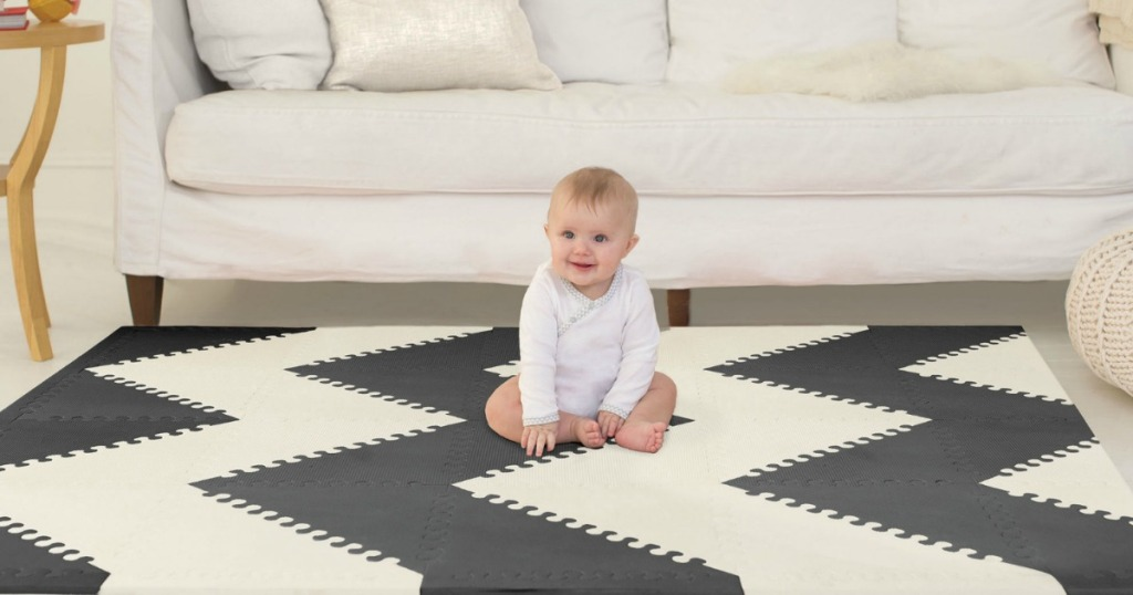 SkipHop brand floor mat in black and white zig zag in a living room