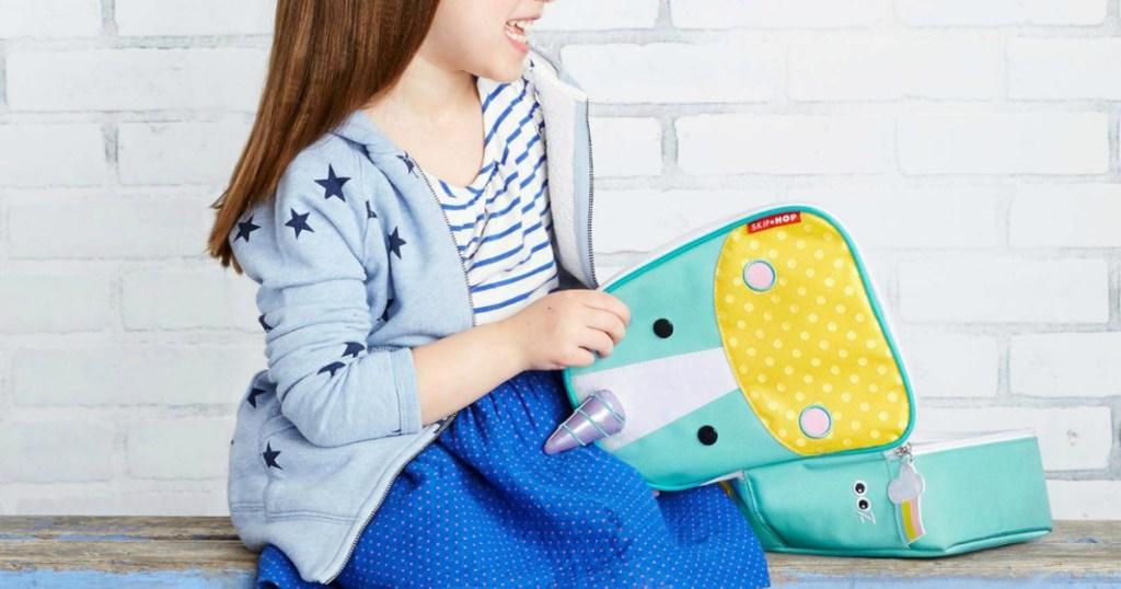 Skip Hop Zoo Kids Eureka Unicorn Lunch Box with little girl holding it open