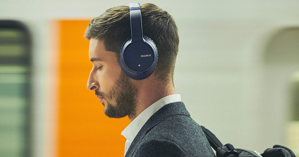 man wearing blue sony headphones