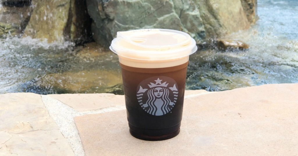 Shot of Nitro at Starbucks with rocks and water in backround