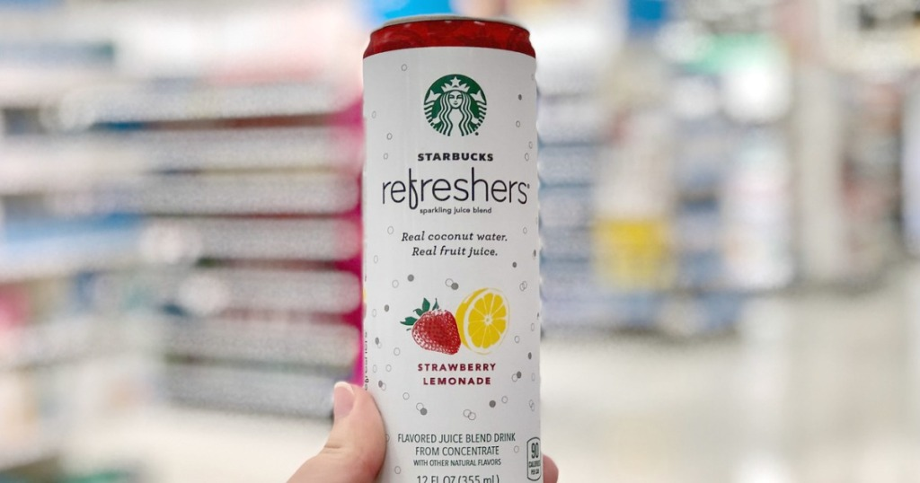 woman holding Starbucks Refreshers Strawberry Lemonade can