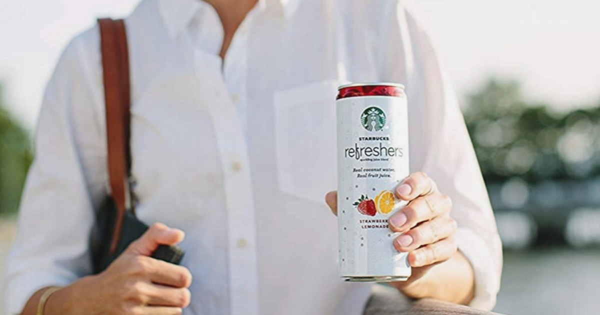 woman holding a can of Starbucks refreshers