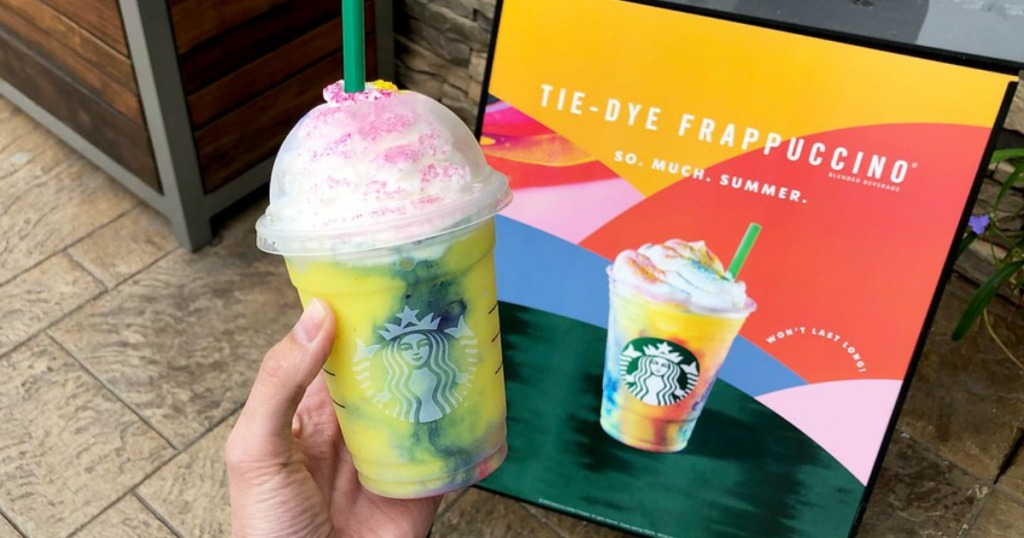 Starbucks Tie-Dye Frappuccino Crème Blended Beverage being held by a woman's hand