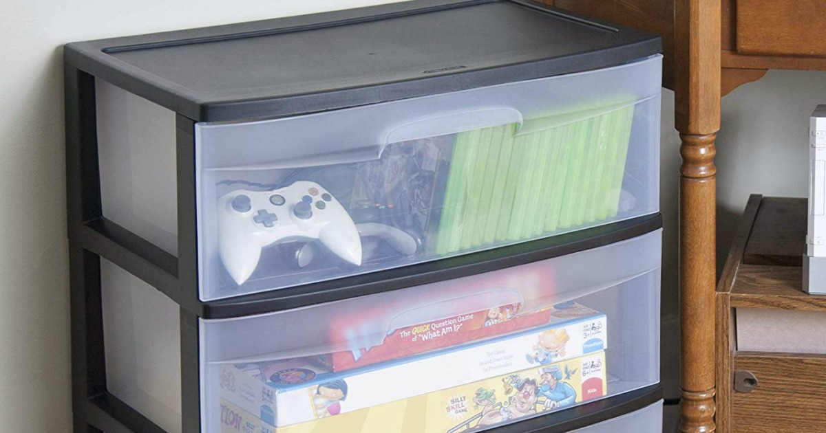 plastic drawers next to wood stand