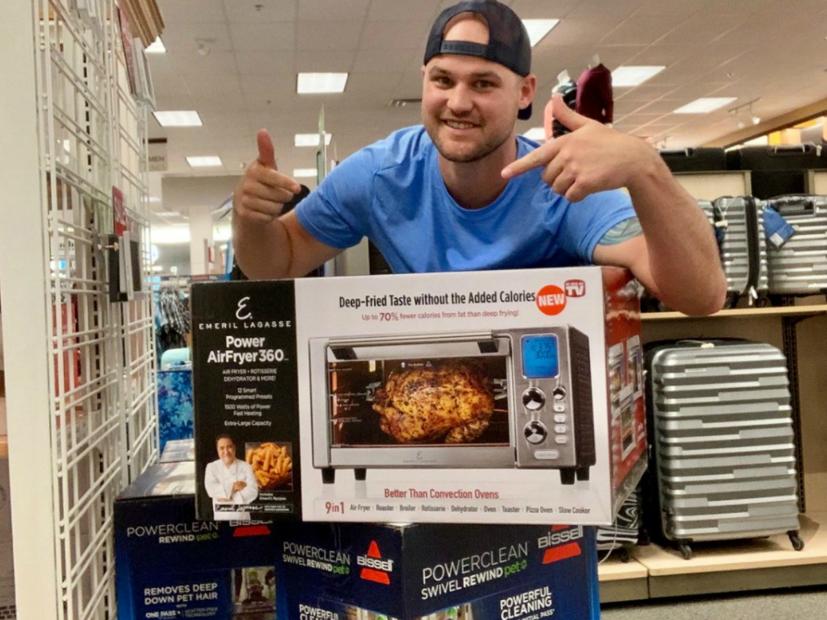 man pointing to Emeril Lagasse air fryer box in-store