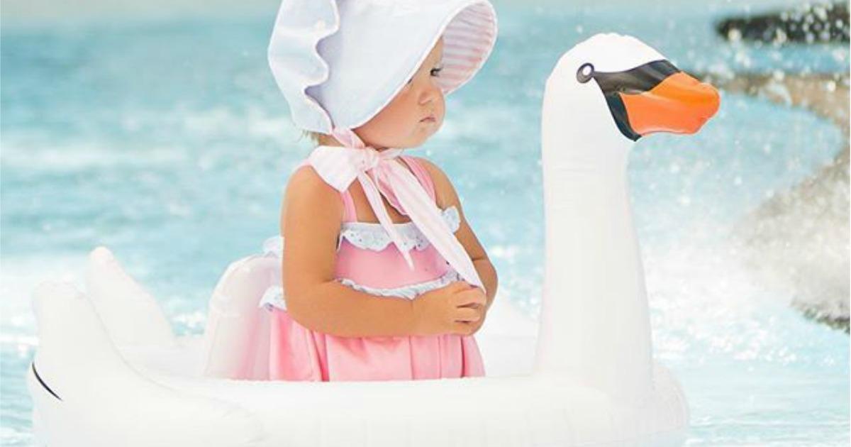 Baby in swan float