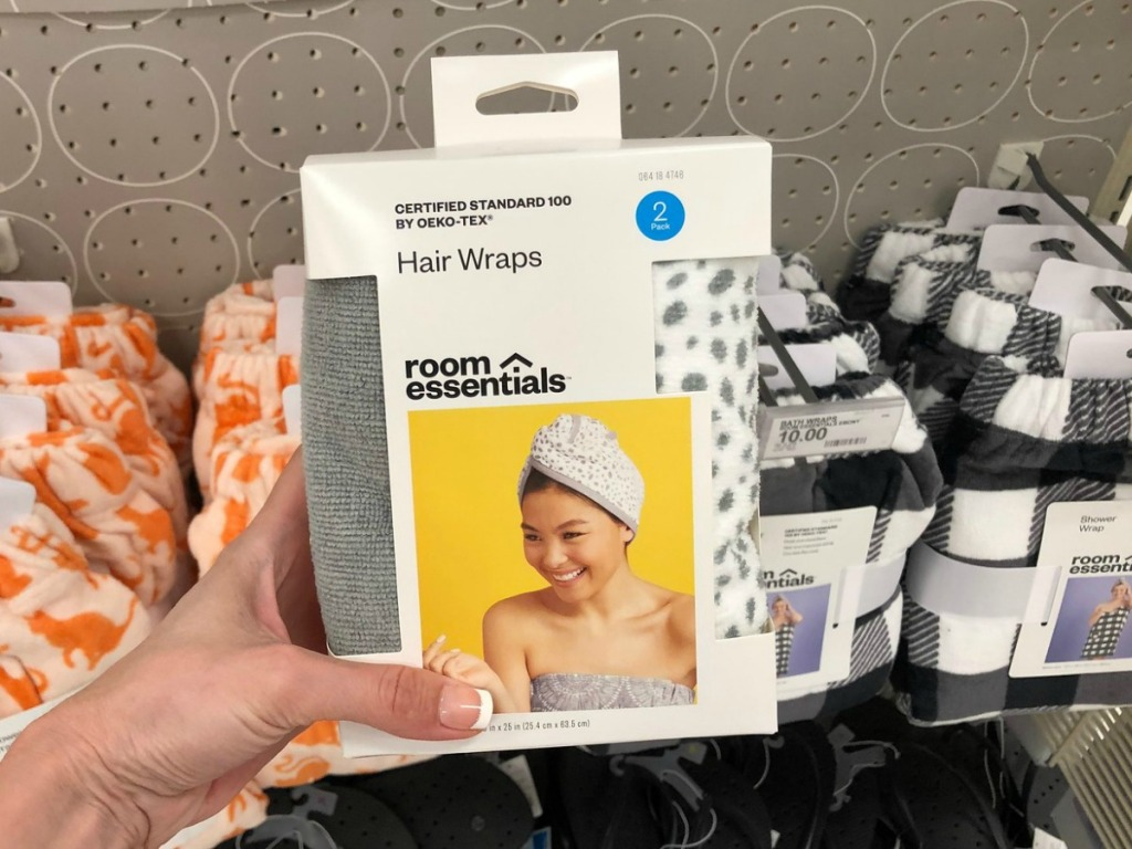hand holding grey hair wrap in packaging inside target store