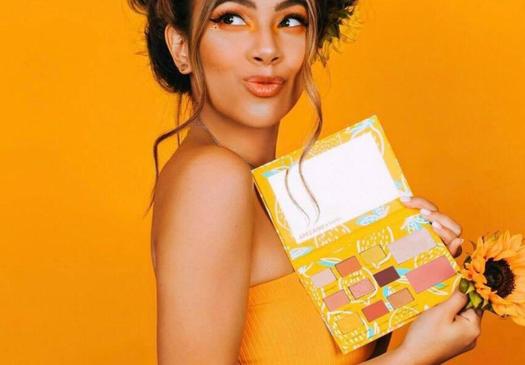 Adelaine Morin holding Tarte Eye & Cheek Palette