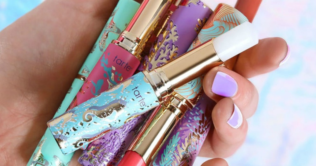 hand holding Tarte Quench Lip Rescue