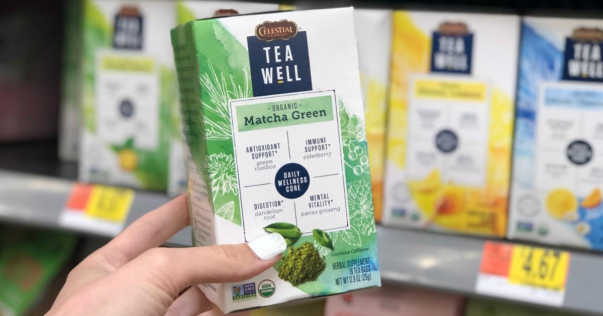 hand holding TeaWell Matcha Green Tea Box