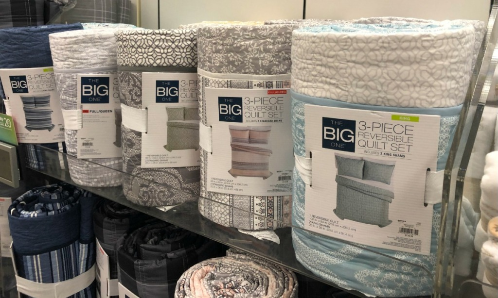 A store display of three piece quilt sets at Kohl's