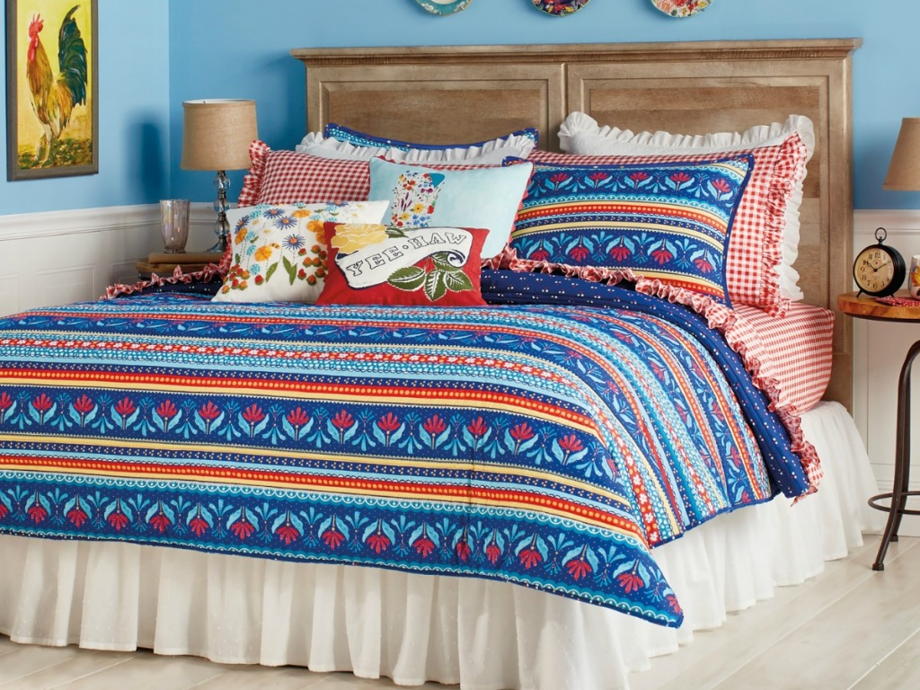 striped quilt on bed with throw pillows
