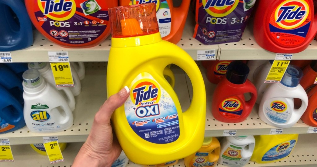 hand holding Tide Simply laundry detergent