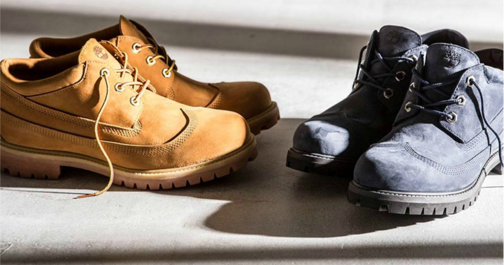 two pairs of men's Timberland boots on mat